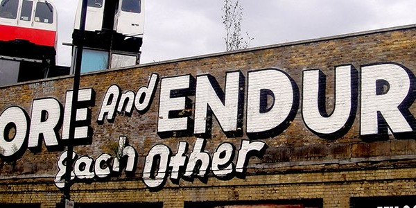 Graffiti let's adore and endure each other words