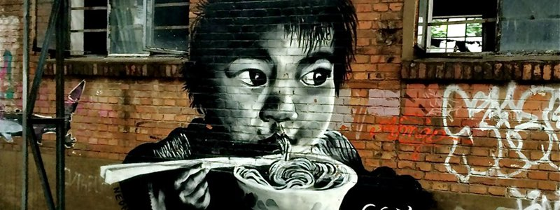 Graffiti of Chinese boy eating noodles