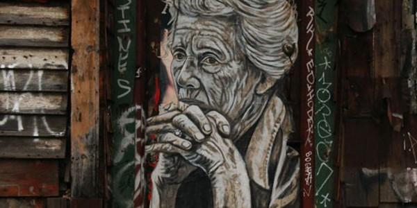 Graffiti of woman by artist Pyramid Oracle.