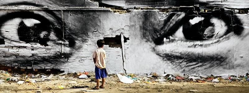 boy looking at giant Graffiti eyes