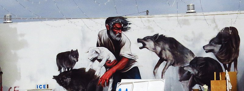 Street Art sheep protected by man from wolves EVPCA1