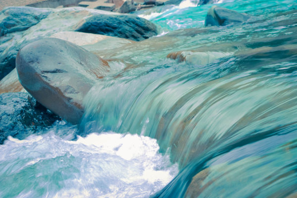 rushing river water over rocks easter header image