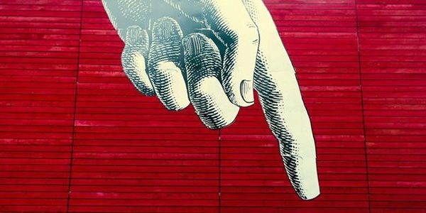 Giant Graffiti Hand pointing to person walking by