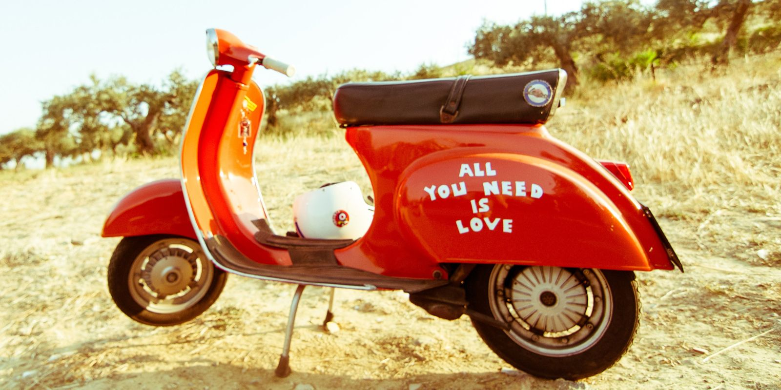 Vintage Vespa with All You Need Is Love on side photo by Davide Ragusa.