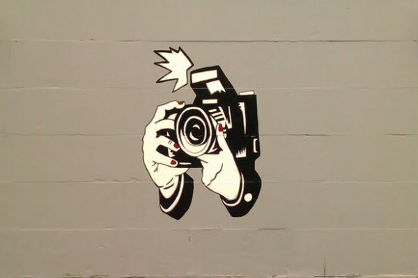street art of a camera taking a photo