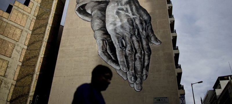 Graffiti artist iNo praying hands artwork