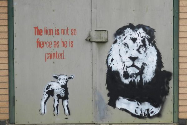 Graffiti art of lion with lamb