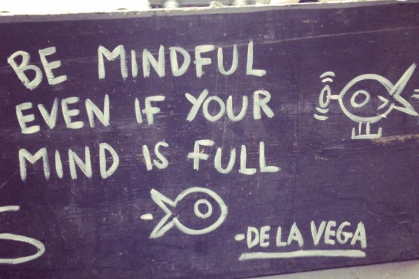 De la Vega street art that reads Be Mindful Even If Your Mind Is Full