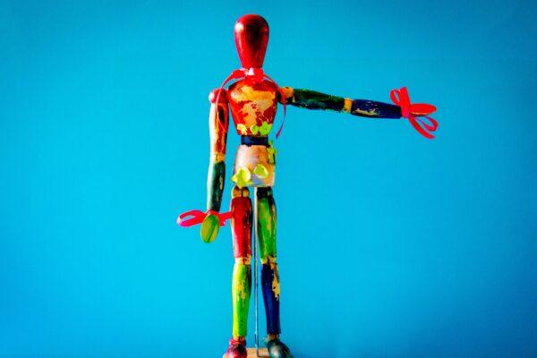 multi-colored wooden figure